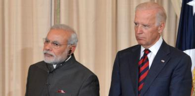 Indian Prime Minister Narendra Modi and President Joe Biden, who was then vice president, at a lunch at the State Department during the Indian leader's visit to Washington in 2014. (File Photo: State Dept)